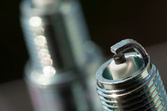 Auto service. Two new spark plugs as spare part of car. Royalty Free Stock Images