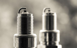 Auto service. Two new spark plugs as spare part of car. Stock Photos
