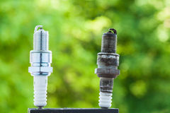Auto service. Two spark plugs as spare part of car. Royalty Free Stock Photography