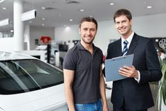 In the auto show. The seller and the buyer in the auto show Stock Photo