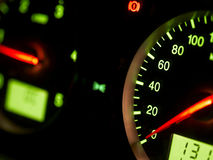 Auto speedometer. A close up and partial view of a lighted vehicle speedometer Royalty Free Stock Photos