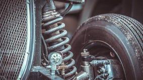 Auto-Stoßdämpfer-Maschinenteil stockfotografie