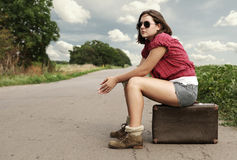 Auto stop traveller on the lonely route Royalty Free Stock Image