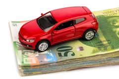 Auto-swiss franc. One car, swiss franc banknotes. cost of purchasing a car, petrol, insurance and other car costs royalty free stock photography