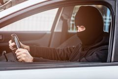Auto thief driving a stolen car Royalty Free Stock Photo