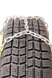 Auto tire and chains. Auto tire chains for snow Royalty Free Stock Image