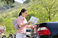 Auto tourist - Korean young woman Royalty Free Stock Photos
