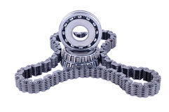 Auto transmission parts. Automotive roller bearings and timing belt on white background stock image