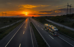 Auto Transporter Truck at Sunset. Auto Transporter Truck on a Sunset Road Stock Photo