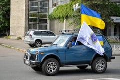 Auto with Ukrainian flags Stock Photo