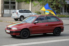 Auto with Ukrainian flags Stock Images