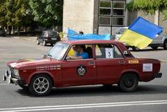 Auto with Ukrainian flags Royalty Free Stock Photo