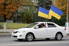 Auto with Ukrainian flags Royalty Free Stock Photos