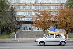 Auto with Ukrainian flags Stock Image