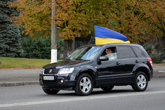 Auto with Ukrainian flags Royalty Free Stock Image