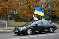 Auto with Ukrainian flags Stock Photos