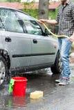 Auto und sein Inhaber Lizenzfreies Stockfoto