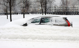 The auto under snow. On the moscower street Stock Image