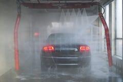 Auto-Wäsche mit geometrischem Spray Lizenzfreies Stockfoto