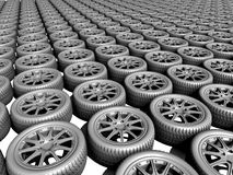 Auto wheel illustration. 3D illustration of rows and rows of automobile wheels and tires.  Grey tone colouring Stock Photography