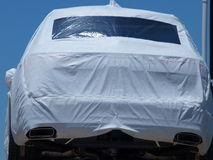 Auto Wrappings. Auto transports preparing new cars for shipment via containers overseas Stock Image