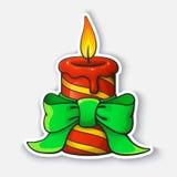 Autoadesivo del fumetto con la candela di Natale con il nastro Fotografie Stock Libere da Diritti