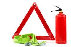 Autoausrüstung Feuerlöscher, Rettungszeichen und Schleppseilseil Lizenzfreie Stockfotografie