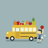 Autobús escolar y fruta Imagen de archivo libre de regalías