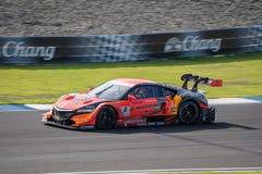 AUTOBACS赛跑的队AGURI的维塔托尼奥・柳齐在GT500 Qualifl的 免版税库存图片