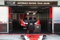 Autobacs Aguri team garage, SuperGT 2010. Autobacs Aguri car 8 team garage, SuperGT round 4 Sepang @ June 2010 stock images