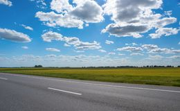 Autobahn on the blue sky background. Stock Photo