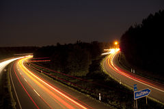 Autobahn exit at night Stock Photos
