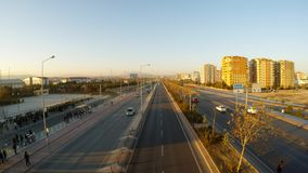 Autobahn and high-rise buildings on the outskirts of the Turkish city of Konia at sunset. KONYA / TURKEY - 11.20.2016 central streets of the ancient Turkish city stock video