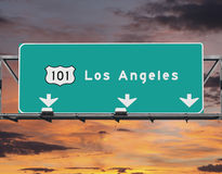 101 Autobahn-Los Angeles-Sonnenaufgang-Himmel Lizenzfreies Stockfoto