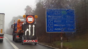 German Highway 3 with signpost. German Highway 3 with sign and winter service Stock Image