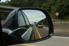 Autobahn in the rearview mirror.  stock photography