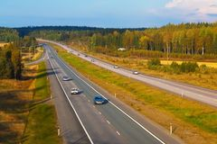 Autobahn traffic. Scenic autumn view of wide autobahn with traffic stock photos