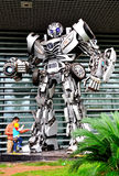 Autobots. A father and son are watching the magic autobot standing in front of gate.Taken at the Chana Auto Exhibition in Chongqing Science and Technology Museum Stock Photo