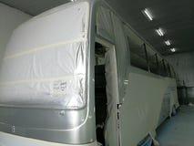 Autobus dans la chambre de jet Photographie stock