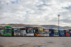 Autobuses in a row, Arequipa station, Peru. Arequipa, Peru - August 18, 2015: Row of autobuses of different companies waiting in Arequipa bus station, Peru Royalty Free Stock Photo