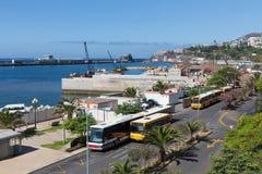 Autobuses y actividades de la construcción en el puerto de Madeira Foto de archivo libre de regalías