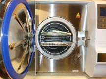 Autoclave for sterilization and disinfection of instruments in a beauty salon stock image