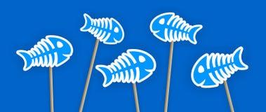 Autocollants bleus d'os de poissons sur le bâton Photographie stock libre de droits