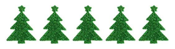 Autocollants verts d'arbre de Noël de scintillement sur un fond blanc Photographie stock