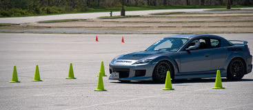 Autocross. A car races against the clock at the Mazda Sportscar Club of Washington's MAX 32 autocross race.  Autocross consists of timed and fun runs on an Royalty Free Stock Photos