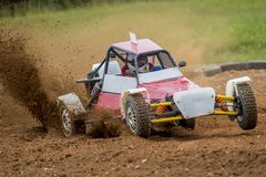 Autocross on a dusty road. Car in competition up the road on a d. Irt road stock photo