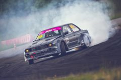 Saint-Petersburg, Russia - August 15, 2018: Powerful race car drifting on speed track Royalty Free Stock Images