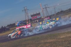 Saint-Petersburg, Russia - August 15, 2018: Powerful race car drifting on speed track Royalty Free Stock Photos