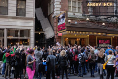 Autograph Seekers. Surround Neil Patrick Harris outside of the New York theater where was performing in Hedwig and the Angry Inch, April 16th, 2014.  Crowd of Stock Photo