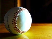 Autographed Baseball. An autographed baseball on a desk stock photography